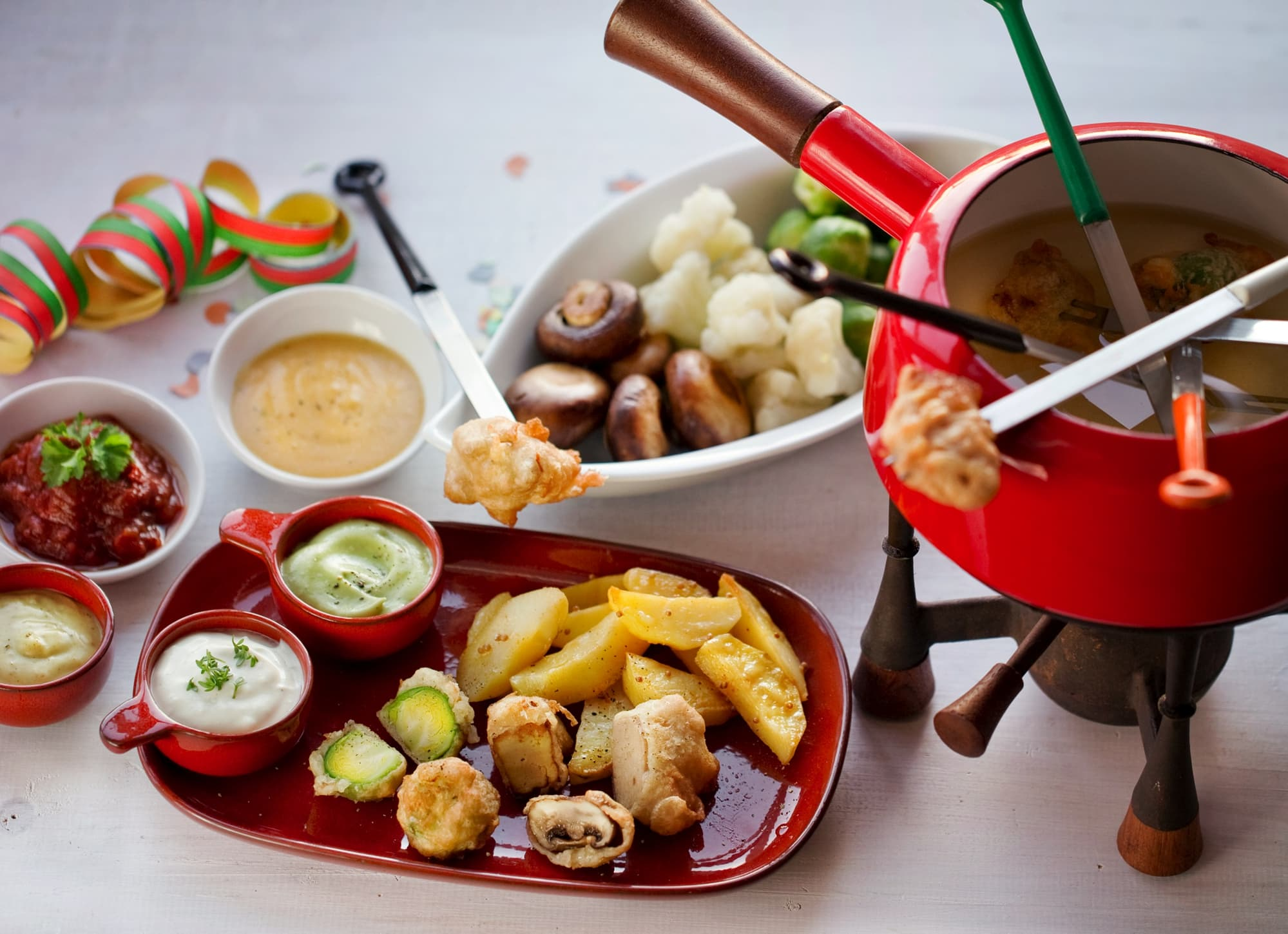 NEW YEAR'S EVE FONDUE: DELICACIES IN BEER BATTER